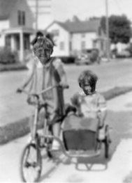 Mary on bike with Dick Klein